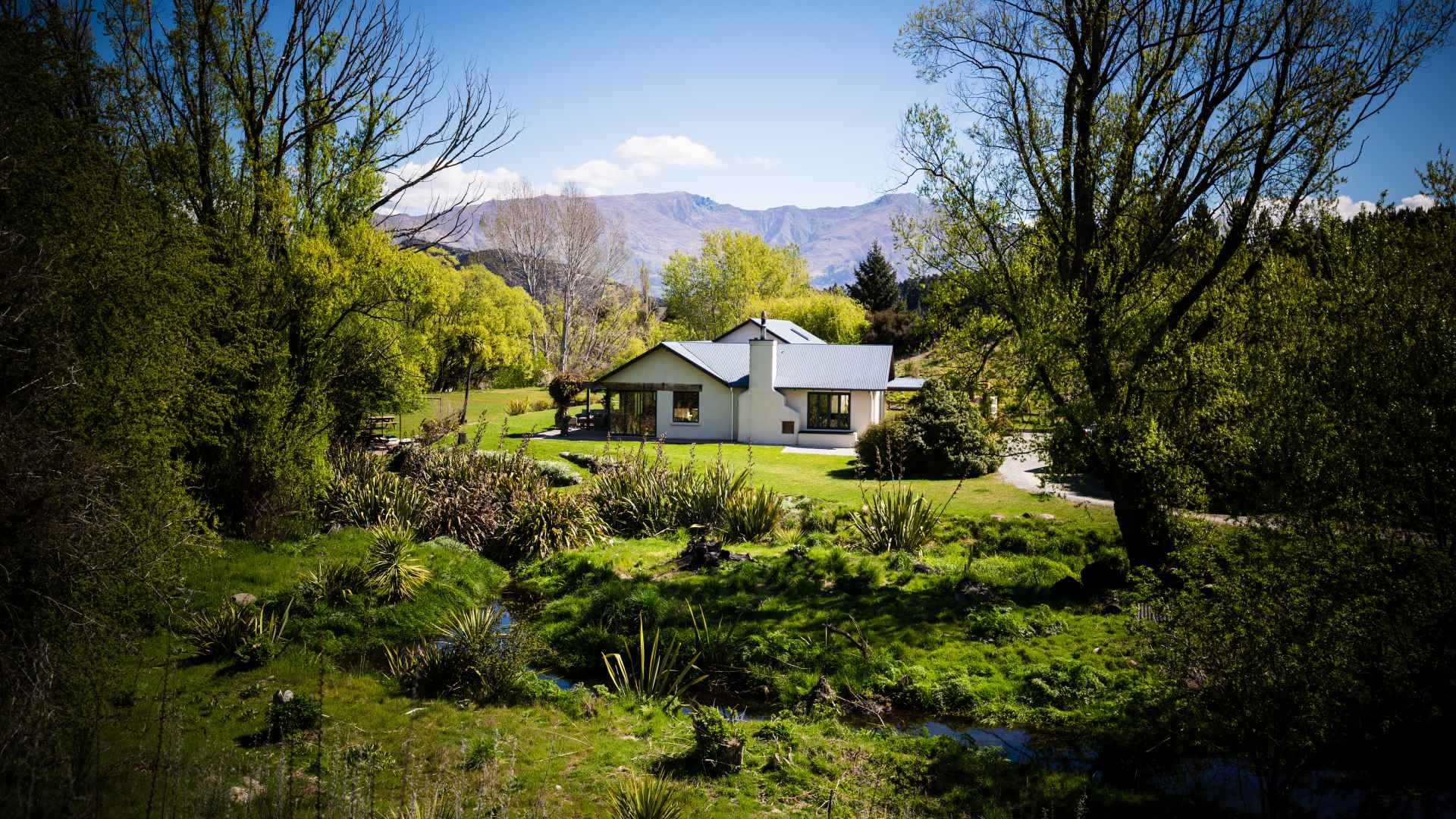 The River House Wanaka surrounded in native harakeke