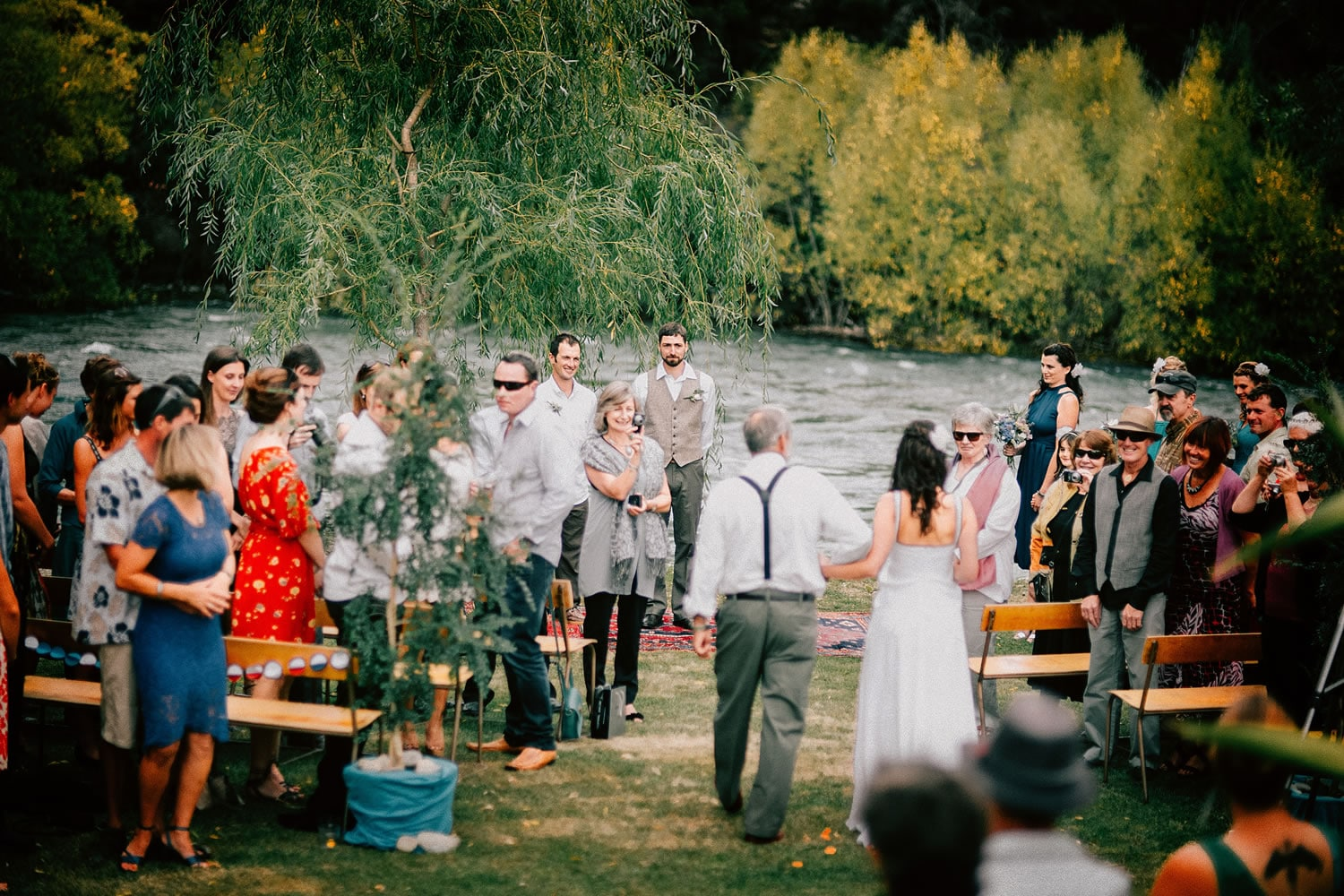 The Bride walking up the aisle at an outdoor wedding at The River House Wanaka